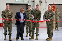 Col. Michael Borqschulte, MAG-39 commanding officer,Sameet Gadi, Balfour Beatty senior vice president, Brig. Gen. Edward D. Banta, MCI-West Commanding Genera and Col. Ian R. Clark, Marine Corps Air Station Camp Pendleton commanding officer, cut a ribbon to unveil hangar six in MCAS Camp Pendleton, a hangar uniquely designed with the purpose of storing and maintaining MV-22 Ospreys. (U.S. Marine Corps photo by Cpl. Shaltiel Dominguez/ Released)