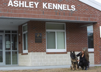 Tammie Ashley sits outside of the 2nd Law Enforcement Battalion kennels with her son's former Military Working Dog, Sirius, at Camp Lejeune, N.C., Feb. 25, 2016. Tammie's son and Sirius' former handler, Sgt. Joshua Ashley, was killed while on patrol in 2012 in support of Operation Enduring Freedom, The Ashley family adopted Sirius after a passing of the leash retirement ceremony. (U.S. Marine Corps Photo by Cpl. Michelle Reif/Released.)