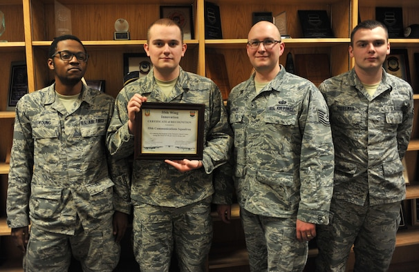 Senior Airman Marquez Young, left, Airman 1st Class Nathaniel Layman, Tech. Sgt. Nathan Hanmer and Airman 1st Class Dominic Steelman, all with the 55th Communications Squadron at Offutt Air Force Base, Neb., hold a 55th Wing Innovation Certificate of Recognition Feb. 23, 2016. They received the award at a recent commander's call after saving the wing $37,500 in annual energy costs. (U.S. Air Force photo/Senior Airman Rachel Hammes)