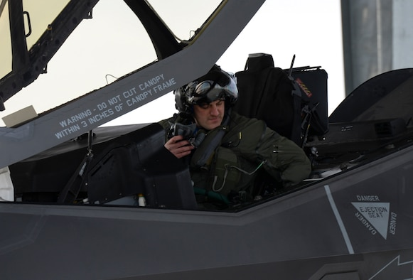 Maj. Ethan Sabin, 31st Test and Evaluation Squadron assistant director of operations, settles into the cockpit of an F-35A at Mountain Home Air Force Base, Idaho, Feb. 12, 2016. Sabin is assigned to the 31st TES from Edwards AFB, Calif., which is part of the 53rd Wing headquartered at Eglin AFB, Fla. (U.S. Air Force photo by Airman 1st Class Jessica H. Evans/RELEASED)