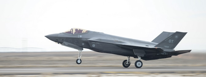 An F-35A ascends into take-off at Mountain Home Air Force Base, Idaho, Feb. 12, 2016. The aircraft is here to execute key mission capabilities as part of a deployment test. (U.S. Air Force photo by Airman 1st Class Jessica H. Evans/RELEASED)