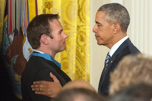 President Barack Obama congratulates Navy Senior Chief Petty Officer Edward C Byers Jr. during a ceremony in which Obama presented Byers with the Medal of Honor at the White House in Washington, D.C. Feb. 29, 2016. DoD photo by EJ Hersom