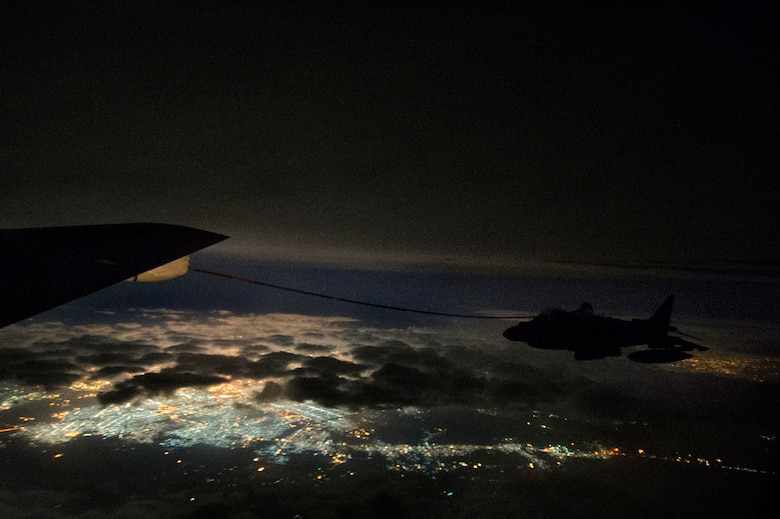 A U.S. Air Force KC-135 Stratotanker assigned to the 340th Expeditionary Air Refueling Squadron refuels a U.S. Marine Corps AV-8B Harrier II over Iraq in support of Operation Inherent Resolve, Dec. 31, 2015.  (U.S. Air Force photo by Tech. Sgt. Nathan Lipscomb)