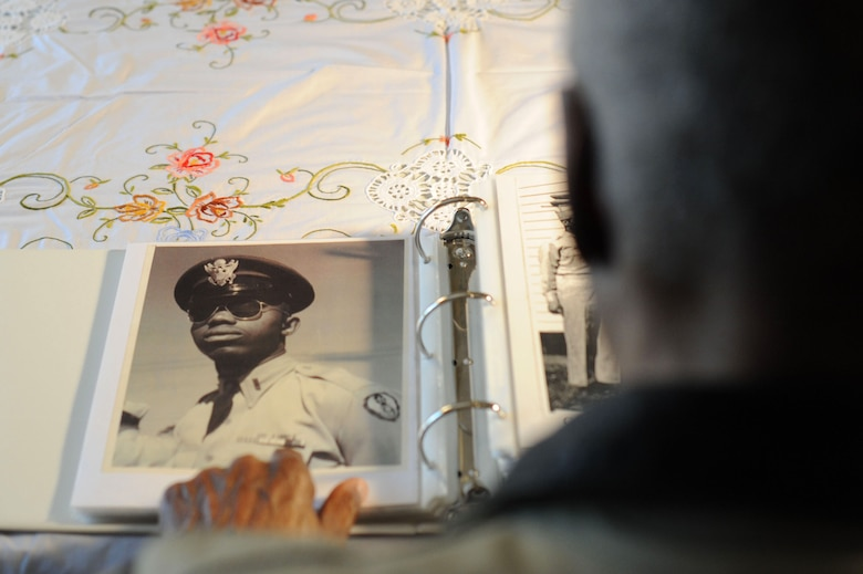 Retired Maj. George Boyd, looks at a photo of himself in service dress when he was younger, Feb. 25, 2016, at his home in Wichita, Kan. Boyd served for nearly three decades as both an enlisted Airman and a commissioned officer and is currently a colonel in the U.S. Civil Air Patrol. (U.S. Air Force photo/Airman 1st Class Christopher Thornbury)