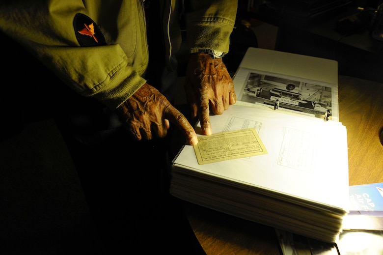Retired Maj. George Boyd, exhibits photographs and other wartime documentation from his time in the service, Feb. 4, 2016, at his home in Wichita, Kan. Boyd served for nearly three decades on both the enlisted and commissioned side.  (U.S. Air Force photo/Airman Jenna K. Caldwell)
