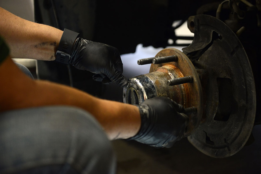 Tony Johnson, a retired Air Force C-130 crew chief, performs maintenance work on his truck at the Automotive skills Center on Joint Base Elmendorf-Richardson, Feb. 24, 2016. The ASC is a 16 bay auto shop that provides assistance with most car repairs. (U.S. Air Force photo by Airman 1st Class Javier Alvarez)