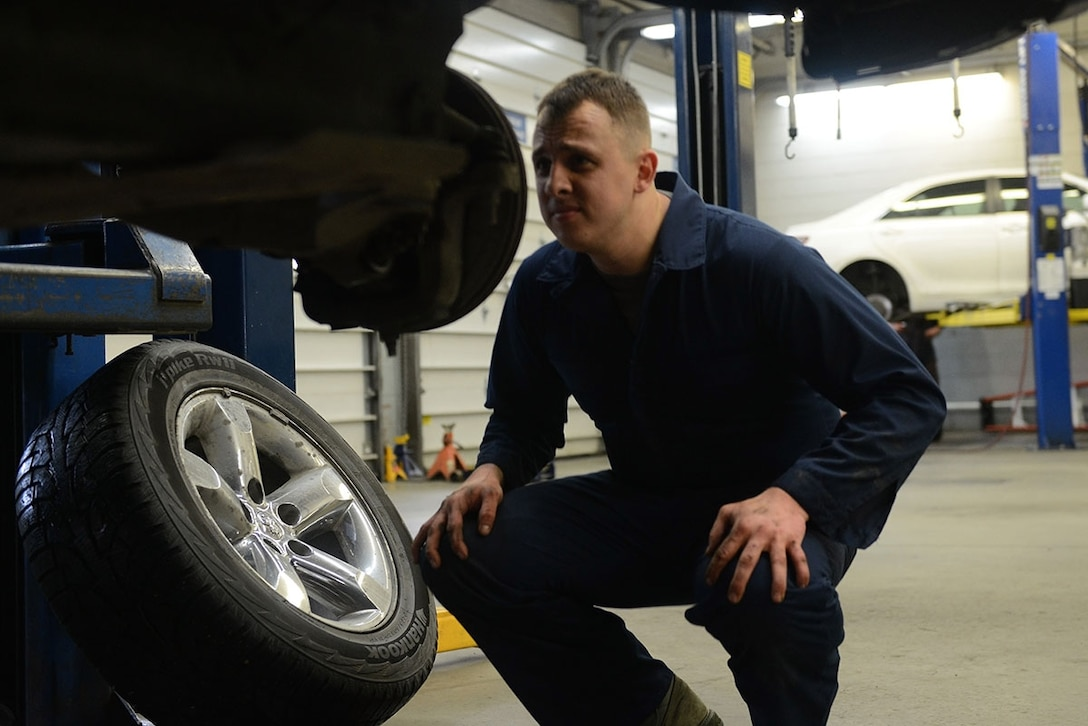 Senior Airman Brian Sanchez, a 732d Air Mobility Squadron aircraft services specialist, inspects the brakes on his truck at the Automotive Skills Center on Joint Base Elmendorf-Richardson, Feb. 24, 2016. Staff at the ASC assist customers performing repairs and maintenance on personally owned vehicles, which makes customers self-reliant. (U.S. Air Force photo by Airman 1st Class Javier Alvarez)