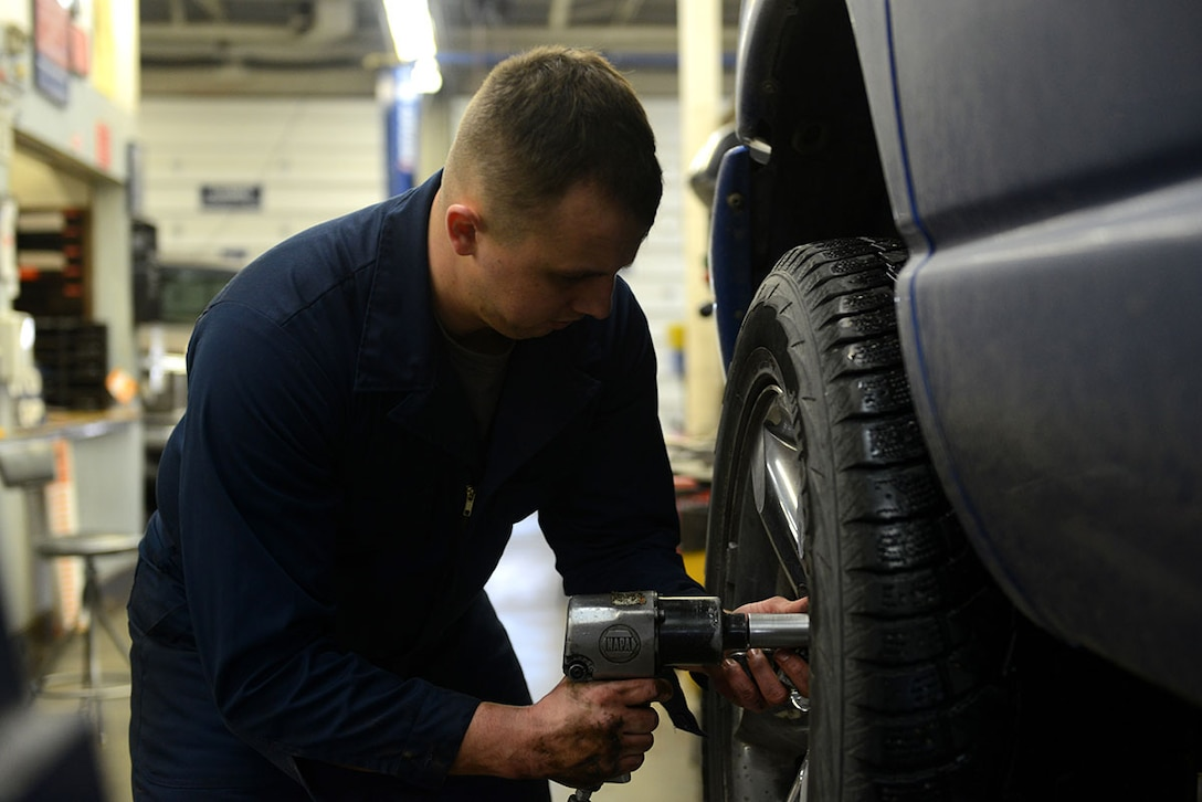 Senior Airman Brian Sanchez, a 732d Air Mobility Squadron aircraft services specialist removes a tire from his vehicle at the Automotive Skills Center on Joint Base Elmendorf-Richardson, Feb 24, 2016. The ASC is available on base to assist with more car repair and maintenance needs. (U.S. Air Force photo by Airman 1st Class Javier Alvarez)