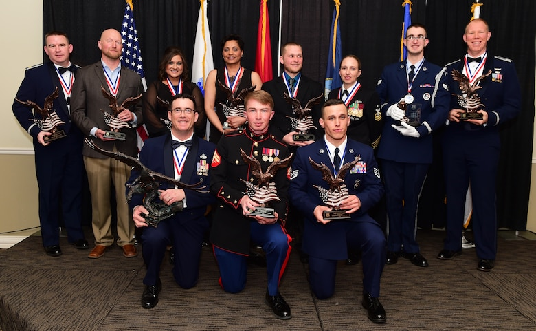 Team Buckley 2015 Annual Award winners pose following a ceremony Feb. 26, 2016, at The Summit in Aurora, Colo. The annual awards included 10 individual awards and one team excellence award and represent the top performers on Buckley Air Force Base, Colo. (U.S. Air Force photo by Senior Airman Racheal E. Watson/Released)