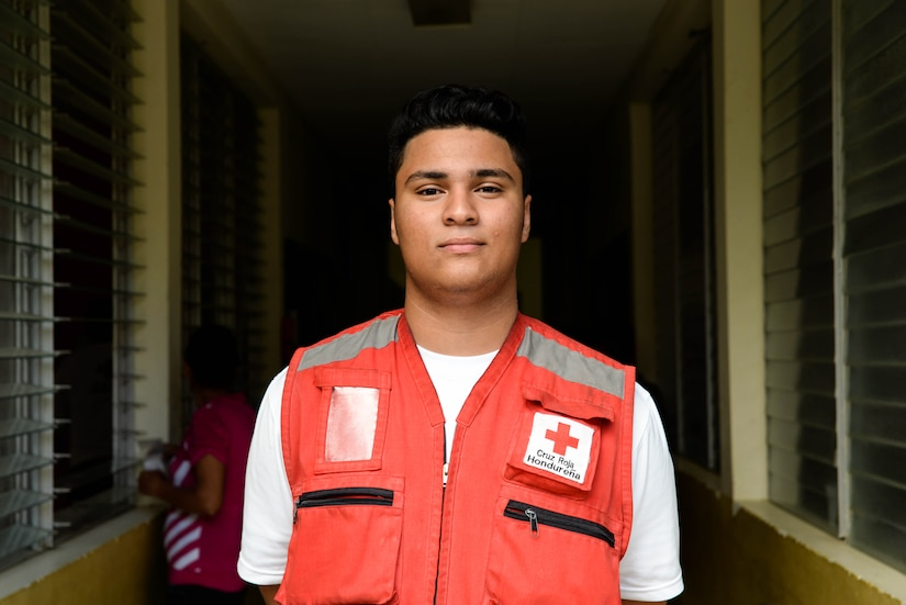 Roy Broonfield, Red Cross volunteer, poses for a photo during a Medical Readiness Training Exercise in the Cortes Department, Honduras, Feb. 19, 2016. Broonfield helped the pharmacy fill over 1,000 prescriptions during a two day MEDRETE on the coastal town North of San Pedro Sula, by translating prescriptions for locals. (U.S. Air Force photo by Staff Sgt. Westin Warburton/Released)