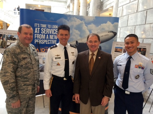 From left, Brig. Gen. David Fountain, Assistant Adjutant General for Air, Maj. Gen. Jefferson Burton, Utah National Guard Adjutant General, Governor Gary R. Herbert, Commander in Chief of the Utah National Guard, and Tech Sgt. Johnson Xaysana, an Air National Guard recruiter, enjoy a photo opportunity during the Utah Defense Alliance Meet the Military luncheon held Feb. 5. The event, held in the Utah State Capitol Bulding Rotunda, provided an opportunity for interaction and dialogue between legislators, military members and civic leaders. (U.S. Air National Guard photo by Senior Master Sgt. Brian Garrett/Released)