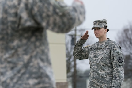 First Sgt. Raquel Steckman salutes her platoon sergeants with the 374th Engineer Company (Sapper), headquartered in Concord, Calif., during formation. Steckman is the first female in the Army appointed to a combat engineer unit as a first sergeant. (U.S. Army photo by Sgt. 1st Class Michel Sauret)