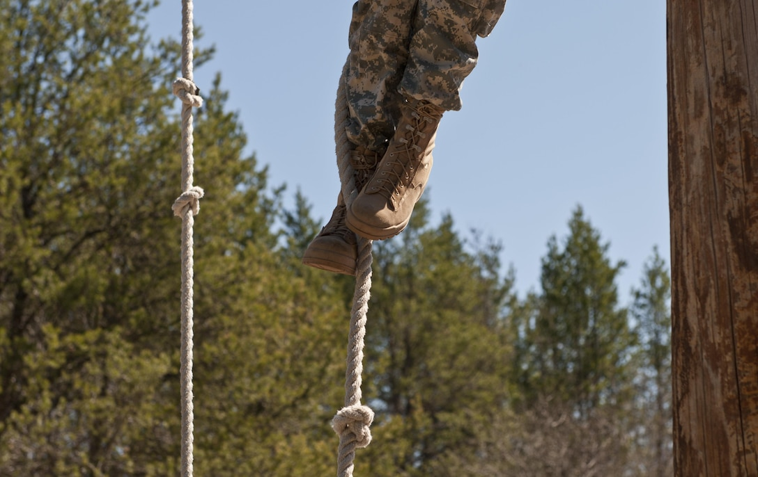 A U.S. Army Reserve Soldier climbs a rope during the obstacle course event of the 2015 Combined Theater Engineer Commands' (TEC) Best Warrior Competition April 27. Approximately 35 U.S. Army Reserve Soldiers with the 412th and 416th TECs are competing for the title of Best Warrior noncommissioned officer and junior enlisted of the 412th and 416th TECs at Fort McCoy, Wis., April 25 to 29. (U.S. Army photo by Staff Sgt. Debralee Best)