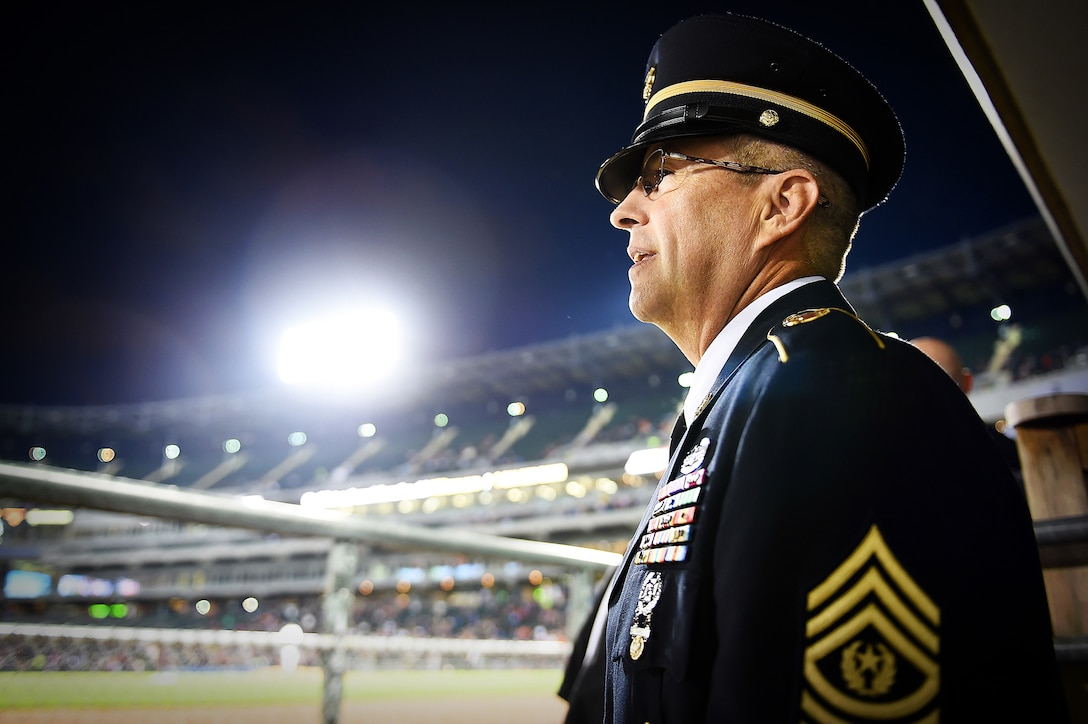 "Army Reserve Command Sgt. Maj. Kevin J. Greene, command sergeant major, 85th Support Command, prepares to walk out onto the field during the Chicago White Sox ""National Day of Remembrance Take the Field' ceremony, Sept. 11. Greene was there with service members and first responders at U.S. Cellular to take part in a recognition during the White Sox home game vs the Minnesota Twins. (U.S. Army photo by Sgt. 1st Class Anthony L. Taylor/Released)"