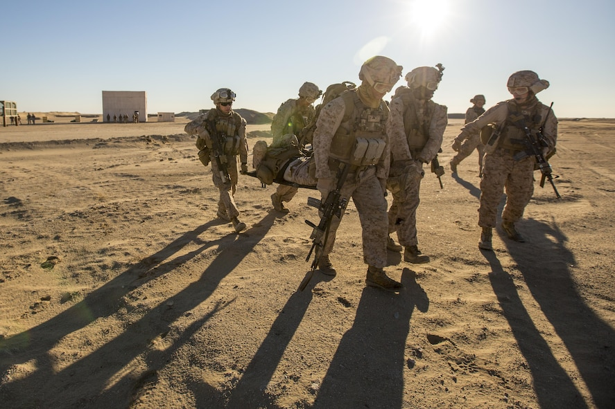U.S. Marines carry a simulated casualty during a tactical exercise to recover aircraft and personnel at an undisclosed location in Southwest Asia, Dec. 28, 2015. The Marines are assigned to 1st Battalion, 7th Marine Regiment, Special Purpose Marine Air-Ground Task Force-Crisis Response Central Command. U.S. Marine Corps photo by Lance Cpl. Clarence Leake