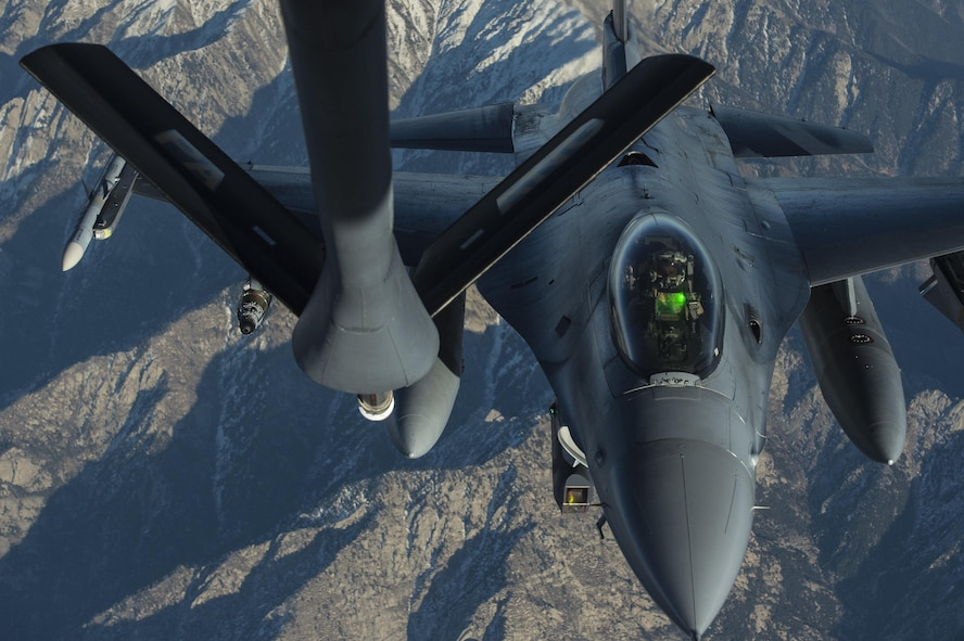 A U.S. Air Force KC-135 Stratotanker refuels a U.S. Air Force F-16 Fighting Falcon as part of the Resolute Support mission over Afghanistan, Dec. 29, 2015. U.S. Air Force photo by Staff Sgt. Corey Hook