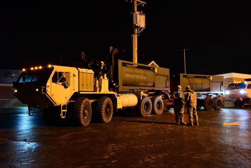 Missouri National Guardsmen stage potable water tankers at High Ridge Elementary School on Dec. 31, 2015.
