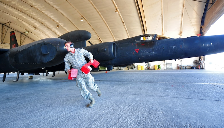 Staff Sgt. Sigfred, Dragon Aircraft Unit maintainer for the U-2 Dragon Lady reconnaissance aircraft, removes aircraft blocks prior to the departure of a U-2 at an undisclosed location in Southwest Asia, Dec. 10, 2015. Despite the variety of manned and unmanned aircraft that have been proposed to take over the U-2's ISR role in the 60 years since its activation, it still remains a primary reconnaissance aircraft for the Air Force. (U.S. Air Force photo by Staff Sgt. Kentavist P. Brackin/released)
