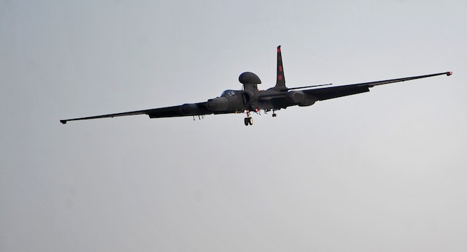 A U-2 Dragon Lady reconnaissance aircraft comes in for a landing at an undisclosed location in Southwest Asia, Dec. 22, 2015. Upon landing, pilots must balance the U-2's unsupported 105-foot wingspan while bringing the aircraft to a halt.