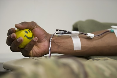 Pfc. Zeon Battise, Guard Force, donates platelets at Craig Joint Theater Hospital on Bagram Airfield, Afghanistan, Dec. 31, 2015. In order to extract platelets, a critical life saving blood component, apherisis machines are used to draw blood and return the unused portions to the donor. (U.S. Air Force photo/Tech. Sgt. Robert Cloys)