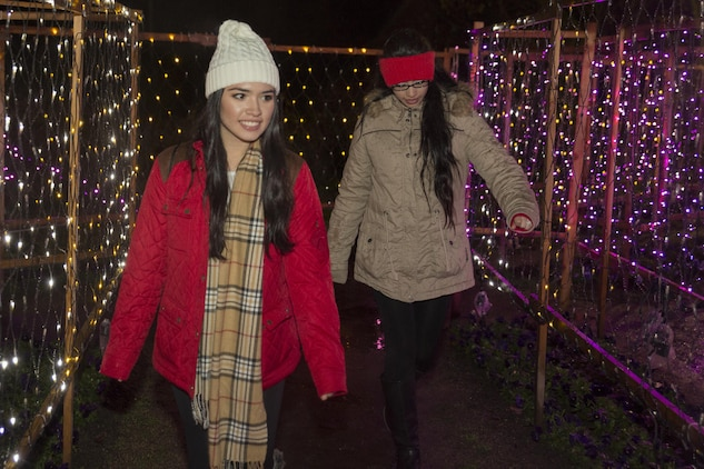 Michelle Vazquez, left, and Haily Galarza, program assistants with the Youth and Teen Center at Marine Corps Air Station Iwakuni walk through the maze of light at the Hiroshima Botanical Garden in Hiroshima City, Japan, Dec. 23, 2015. Residents watched as thousands of lights turned on and transformed the garden into a luminous display.