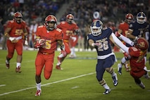 A.J. Taylor, an athlete from Rockhurst High School, Kansas City, Mo., runs the football during the Semper Fidelis All-American Bowl at the Stubhub Center, Carson, Calif., Jan. 3, 2016. High school athletes chosen to play in the Semper Fidelis All-American Bowl are well-rounded individuals on and off the field who not only are distinguished athletes, but also have academic achievements and display exemplary moral character. (U.S. Marine Corps photo by Sgt. Rebecca Eller)