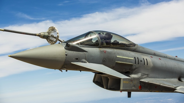 A Eurofighter Typhoon with the Spanish Air Force based out of Morón Air Base, Spain, refuels from a KC-130J Hercules, a first for the Marines from Special-Purpose Marine Air-Ground Task Force Crisis Response-Africa, Aug. 13, in Spain. The U.S. and Spain have been fostering one of the closest defense partnerships around the world for more than 60 years.