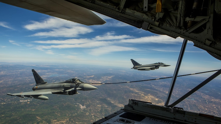 A Eurofighter Typhoon with the Spanish Air Force receives fuel from a U.S. Marine KC-130J Hercules with Special-Purpose Marine Air-Ground Task Force Crisis Response-Africa, August 13, in Spain. A total of five Spanish pilots and their aircraft had the opportunity to practice their air-to-air refueling skills with the Marines from SPMAGTF-CR-AF. While this particular training was a first for the two countries, the U.S. and Spain work together routinely, fostering one of the closest defense partnerships around the world.