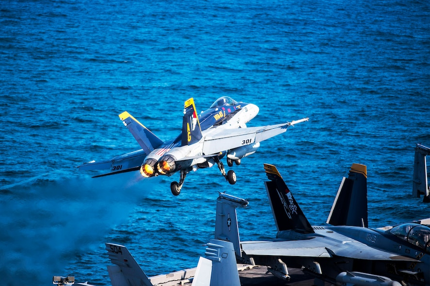 """An F/A-18C Hornet launches from the flight deck of aircraft carrier USS Harry S. Truman in the Arabian Gulf, Dec. 31, 2015. The Harry S. Truman Carrier Strike Group is deployed in support of Operation Inherent Resolve, maritime security operations and theater security cooperation efforts in the U.S. 5th Fleet area of operations. The hornet is part of the """"Rampagers"""" of Strike Fighter Squadron 83. U.S. Navy photo by Petty Officer 3rd Class J. R. Pacheco"""