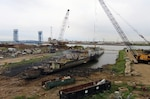 The USS Forrest Sherman, a former Navy destroyer, sits in a trench in New Orleans in October. The ship is the first scrapped through a Defense Logistics Agency contract since the late 1990s.