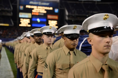 Approximately 250 Marines carry the Big Flag onto the field of Qualcomm Stadium at San Diego, Calif., during the pre-game show of the 38th annual Holiday Bowl, Dec. 30, 2015. The flag, weighing 850 pounds, spans the entire field and requires a minimum of 250 people to support it while unfurled. The Marines are with I Marine Expeditionary Force at Marine Corps Base Camp Pendleton and Marine Corps Air Station Miramar. The University of Wisconsin Badgers emerged victorious over the University of Southern California Trojans with a final score of 23-21. (U.S. Marine Corps photo by Lance Cpl. Timothy Valero)