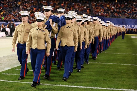 Approximately 250 Marines carry the Big Flag onto the field of Qualcomm Stadium at San Diego, Calif., during the pre-game show of the 38th annual Holiday Bowl, Dec. 30, 2015. The flag weighs 850 pounds and spans the entire field. The Marines are with I Marine Expeditionary Force at Marine Corps Base Camp Pendleton and Marine Corps Air Station Miramar. The University of Wisconsin Badgers emerged victorious over the University of Southern California Trojans with a final score of 23-21. (U.S. Marine Corps photo by Lance Cpl. Timothy Valero)