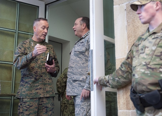U.S. Marine Corps Gen. Joseph F. Dunford Jr., left, chairman of the Joint Chiefs of Staff, speaks with U.S. Air Force Gen. Philip M. Breedlove, commander, U.S. European Command, and Supreme Allied Commander Europe, at the Eucom headquarters in Stuttgart, Germany, Jan. 4, 2016. DoD photo by Navy Petty Officer 2nd Class Dominique A. Pineiro