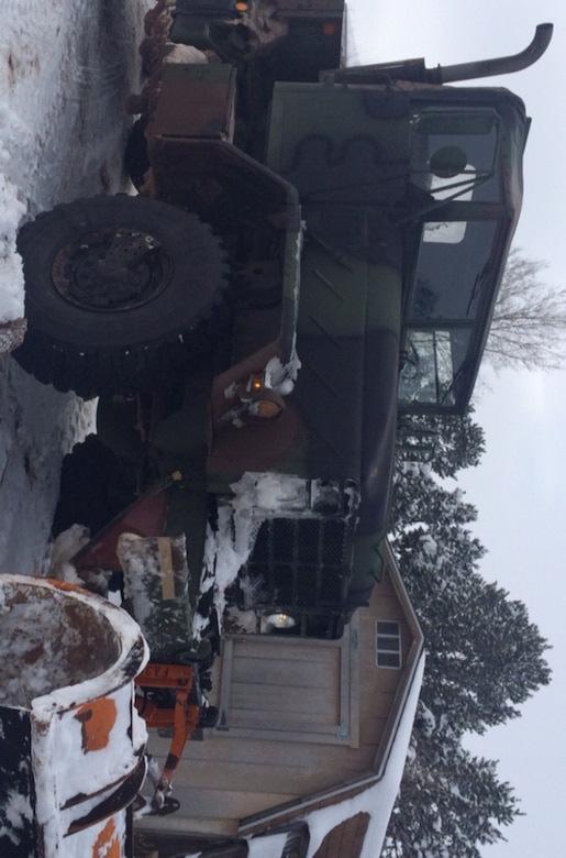 A former Army 5-ton tractor truck acquired by the Torrance County, New Mexico Sheriff's Department through the DLA Law Enforcement Support Office waits for its next mission Dec. 26. Repurposed with a snowplow, the rig was used to reach isolated rural residents of the county in the wake of heavy snow from Winter Storm Goliath.