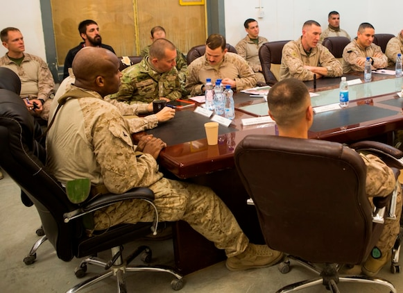 Joint U.S. and Danish service members with Task Force Al Asad discuss current and planned support to the Iraqi Security Forces during an operations and intelligence staff meeting at Al Asad Air Base, Iraq, Dec. 29, 2015. The task force's mission is to enable the al-Jazira al-Badiyah Operations Center and the 7th Iraqi Army Division through building partner capacity, and advise and assist support. The operations center conducts combat operations against Daesh (an Arabic acronym for ISIL) in the Euphrates River Valley. By enabling Iraqi Security Forces through advise and assist, and building partner capacity missions, the Combined Joint Task Force – Operation Inherent Resolve's multinational coalition is helping the Government of Iraq to set the conditions to defeat Daesh. (U.S. Marine Corps photo by Sgt. Owen Kimbrel/Released)