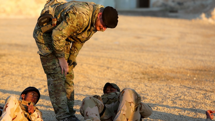 A member of the Royal Danish Army, attached to Task Force Al Asad, checks to see if an Iraqi soldiers has applied a tourniquet properly during a combat life savers course at Al Asad Air Base, Iraq, Dec. 29. 2015.  The task force has trained approximately 2,700 Iraqi soldiers with the 7th Iraqi Army Division through the building partner capacity program. By enabling Iraqi Security Forces through advise and assist, and building partner capacity missions, the Combined Joint Task Force - Operation Inherent Resolve's multinational coalition is helping the Government of Iraq to set the conditions to defeat the Islamic State of Iraq and the Levant.
