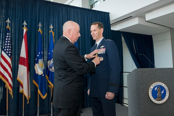 Former Air Force Chief of Staff Gen. T. Michael Moseley pins the Distinguished Service Medal on Lt. Gen. Stanley E. Clarke III during the former's retirement ceremony at the Air National Guard Readiness Center, Joint Base Andrews, Md., December 18, 2015. Clarke is the 15th director of the ANG and retired after 34 years of service. (Air National Guard photo by Master Sgt. Marvin R. Preston/Released)