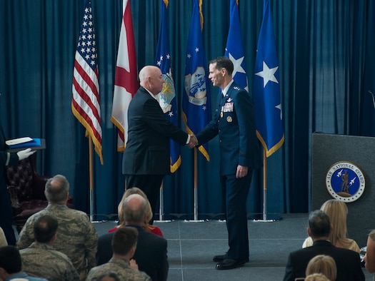 Retired General T. Michael Moseley, former Air Force chief of staff, and Lt. Gen. Stanley E. Clarke, III, Air National Guard director, exchange a handshake after Clarke is awarded the Legion of Merit during Clarke's retirement ceremony held at the Air National Guard Readiness Center on Joint Base Andrews, Md., December 18, 2015. Clarke is the 15th ANG director, and has served in that position since March, 2013. (U.S. Air National Guard photo by Staff Sgt. John E. Hillier/Released)