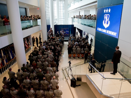 Retired General T. Michael Moseley, former Air Force chief of staff, and Lt. Gen. Stanley E. Clarke, III, Air National Guard director, lead the crowd in the Air Force Song, during Clarke's retirement ceremony held at the Air National Guard Readiness Center on Joint Base Andrews, Md., December 18, 2015. Clarke is the 15th ANG director, and has served in that position since March, 2013. (U.S. Air National Guard photo by Staff Sgt. John E. Hillier/Released)