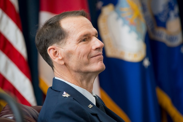 Lt. Gen. Stanley E. Clarke III listens while retired Air Force Chief of Staff Gen. T. Michael Moseley reflects on Clarke's career during the former's retirement ceremony at the Air National Guard Readiness Center, Joint Base Andrews, Md., December 18, 2015. Clarke is the 15th director of the Air National Guard. Clarke is the 15th director of the ANG and retired after 34 years of service. (Air National Guard photo by Master Sgt. Marvin R. Preston/Released)
