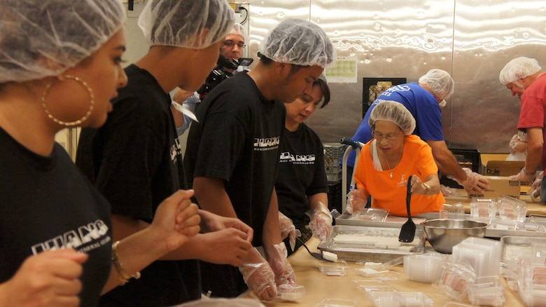 Members of the Hawaii Air National Guard joined 200 Lanakila Meals on Wheels volunteers in preparing over 700 meals for home bound elderly, Dec. 25, 2015, Honolulu. Members of the HIANG have been assisting in meal preparation and delivery on Thanksgiving and Christmas mornings for more than 10 years. Lanakila Pacific is a nonprofit organization that builds independence for thousands of people living challenged lives. (U.S. Air National Guard Photo by Tech. Sgt. Andrew Jackson/released)