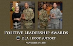 From left to right, Yvonne Poplawski, a division chief with Medical, and Air Force. Col. Glenn Chadwick, Industrial Hardware director, are presented with Positive Leadership Awards Nov. 19 by Army Brig. Gen. Charles Hamilton, DLA Troop Support commander. Both were nominated for the awards by their employees.
