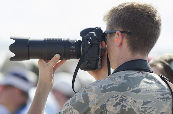 Air Force Airman Zachary Bumpus takes a photo of the U.S. Air Force Thunderbirds preparing for their performance during the 2015 Joint Base Andrews Air Show Sept. 19, 2015. Bumpus is one of 20 Basic Photojournalist Course students from the Defense Information School who augmented members of the JB Andrews Public Affairs staff during the air show. The students facilitated civilian media access, aided visitors from the information booths and took photos of visitors and air show performances.