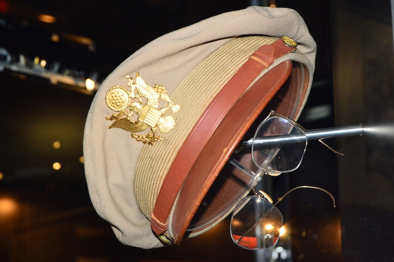 Maj. Glenn Miller's summer uniform cap and spare eyeglasses on display in the World War II Gallery at the National Museum of the United States Air Force. (U.S. Air Force photo)