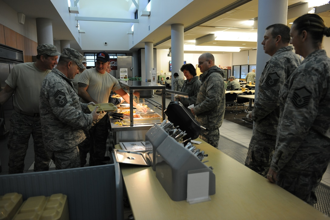 Airmen at the 174th Attack Wing are seen being served breakfast by the wing's enlisted leadership at Hancock Field Air National Guard Base's Annual Chief's Breakfast held  Dec. 16, 2015. (U.S. Air National Guard photo by Tech. Sgt. Jeremy M. Call/Released)