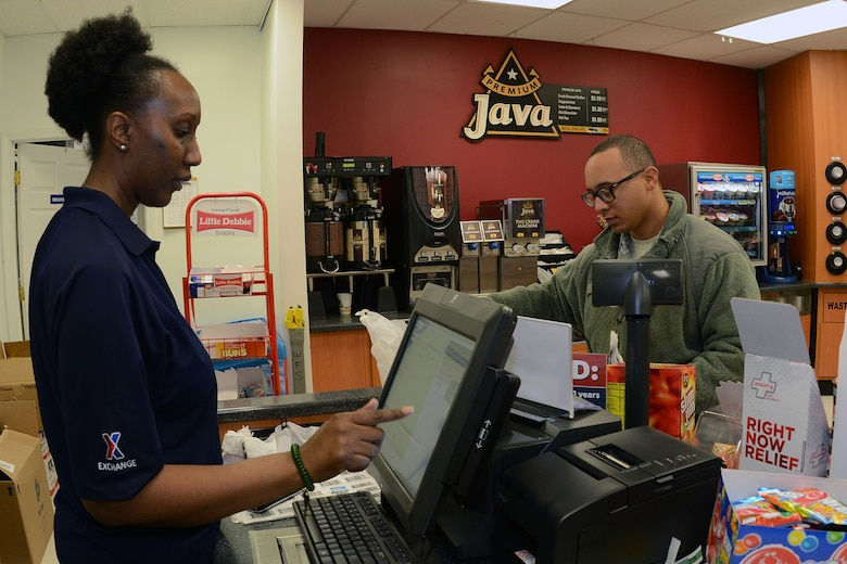 U.S. Air Force Staff Sgt. Ladarias Boyd (right), an avionics technician with the 169th Aircraft Maintenance Squadron, pays Ms. Latia Dawson (left), a shift supervisor for the Base Exchange, for his items at the BX on McEntire Joint National Guard Base, S.C., Jan. 5, 2016. The BX offers a variety of options for their customers while also contributing to the community. (U.S. Air National Guard photo by Airman Megan Floyd/Released)