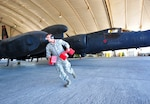 Staff Sgt. Sigfred, a U-2S reconnaissance aircraft maintainer, removes aircraft blocks prior to the departure of a U-2S at an undisclosed location in Southwest Asia, Dec. 10, 2015. (U.S. Air Force photo/Staff Sgt. Kentavist P. Brackin)
