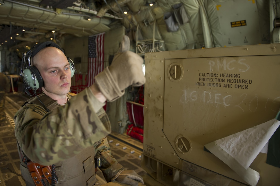 Staff Sgt. Justin King, a 774th Expeditionary Airlift Squadron loadmaster, gives a thumbs-up as a generator is offloaded from a C-130J Super Hercules at Camp Bastion, Afghanistan, Jan. 3, 2016. Loadmasters are responsible for calculating aircraft weight, balancing records and cargo manifests, conducting cargo and personnel airdrops, and troubleshooting in-flight problems. King is deployed from Dyess Air Force Base, Texas. (U.S. Air Force photo/Tech. Sgt. Robert Cloys)
