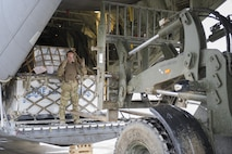 Staff Sgt. Justin King, a 774th Expeditionary Airlift Squadron loadmaster, guides a forklift toward the aft loading ramp of a C-130J Super Hercules at Camp Bastion, Afghanistan, Jan. 3, 2016. Loadmasters are responsible for calculating aircraft weight, balancing records and cargo manifests, conducting cargo and personnel airdrops, and troubleshooting in-flight problems. King is deployed from Dyess Air Force Base, Texas. (U.S. Air Force photo/Tech. Sgt. Robert Cloys)