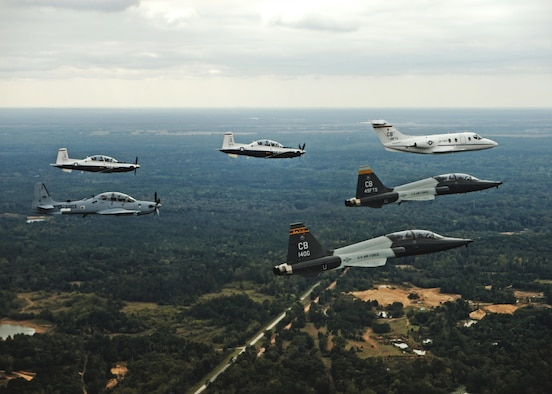 An aircraft from each of the 14th Flying Training Wing flying squadrons were represented in a dissimilar formation in the vicinity of Columbus Air Force Base, Mississippi Oct.1, 2015. The formation was led by the T-1A Jayhawk and flanked by two T-6A Texan II aircraft on its left, two T-38C Talon aircraft on its right and followed by the A-29 Super Tucano behind it. (U.S. Air Force photo/Airman 1st Class Daniel Lile)